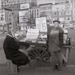 Downtown peanut seller - a cone of peanuts for 15 cents. [Courtesy - Ben Schonzeit]