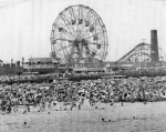 Swimming in front of the Wonder Wheel, in Coney Island, 1956...[Courtesy WT&Sun, Library of Congress]